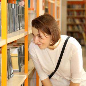 Lady looking at books in a library