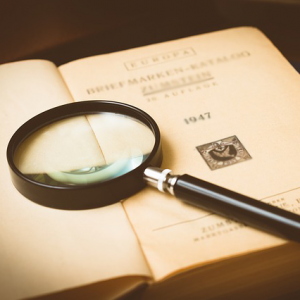 Book with a magnifying glass on it.